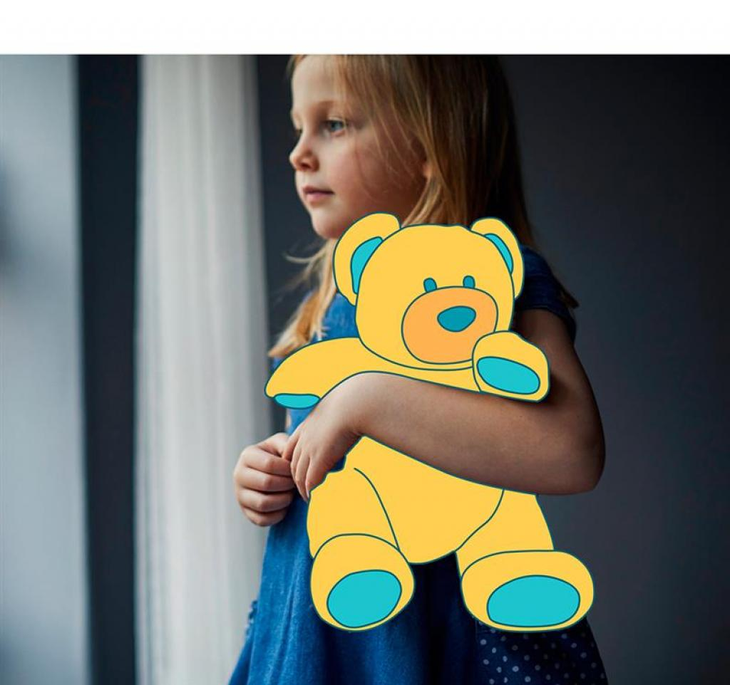 Girl holding teddy
