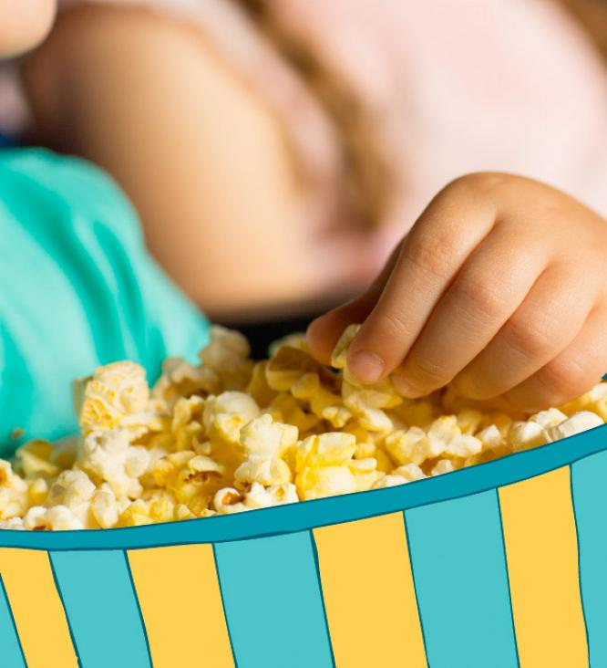 Child eating popcorn