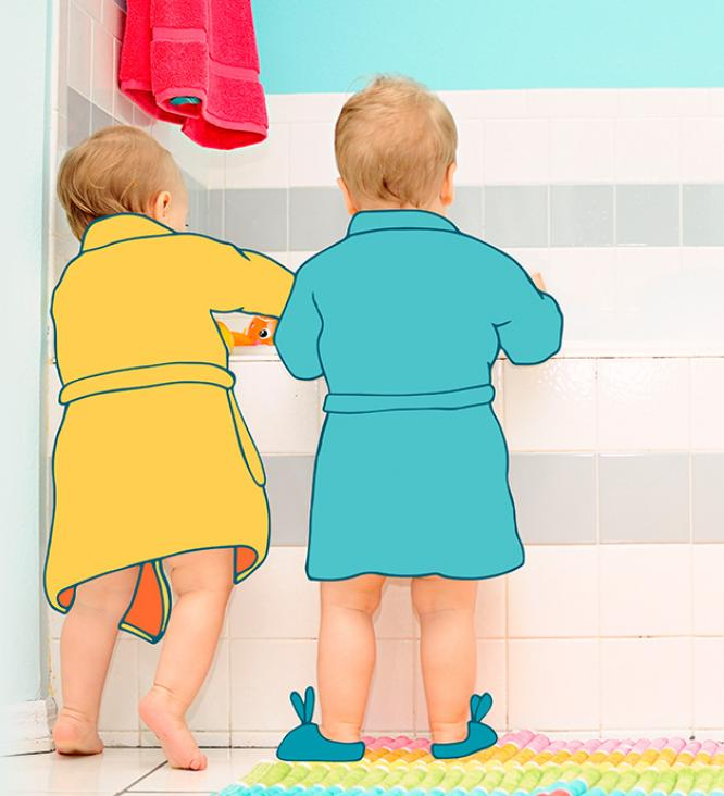 kids in dressing gown standing at bathtub
