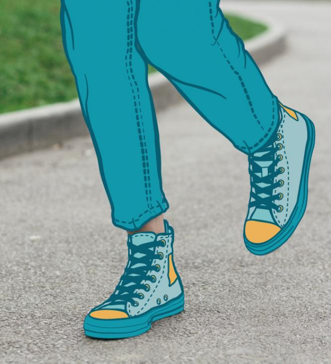 A persons legs wearing pants and sneakers
